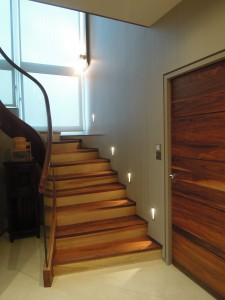Contemporary hallway with walnut & birch accents