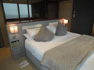 contemporary modern bedroom, illuminating headboard