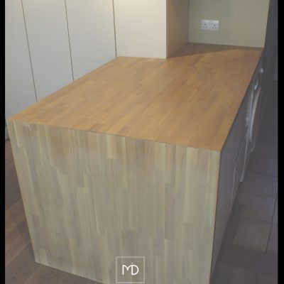 Solid oak counter top and press cabinet storage