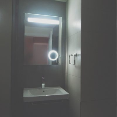 Ambient illumination for this atmospheric bathroom with V&B vanity unit and sandstone porcelain tile
