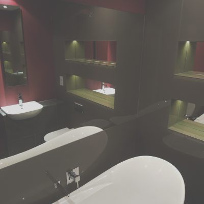 Glass & mirror panelling creating dimension with subtle ambient lighting