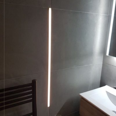 Minimalist design with unique vertical lighting features and ambient illumination