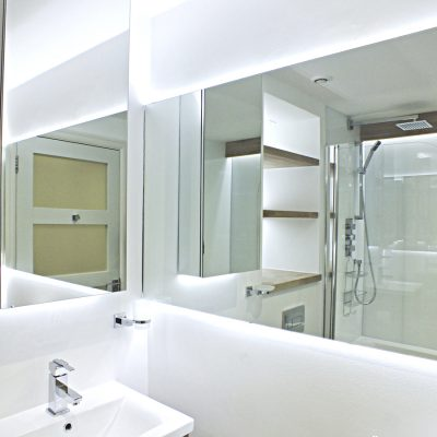Bright with depth. Glass panelling and wood accents with LED accent lighting